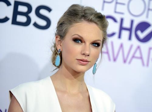 "FILE - This Jan. 9, 2013 file photo shows Taylor Swift at the People's Choice Awards at the Nokia Theatre in Los Angeles. A new girl is coming to Fox's ""New Girl"": Taylor Swift. A representative for the Grammy-winning singer said Thursday, March 28, 2013, that Swift will appear on the May 14 season finale of the hit show. (Photo by Jordan Strauss/Invision/AP, file)"