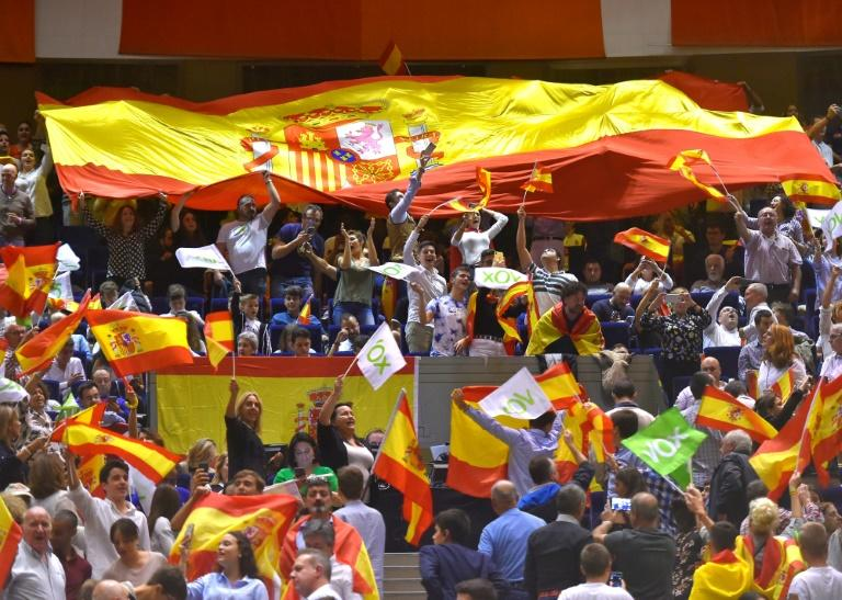 Far-right Vox supporters wave Spanish flags at a campaign rally in Santander last week. Suppport for Vox has been swelled by weeks of Catalan separatist protests