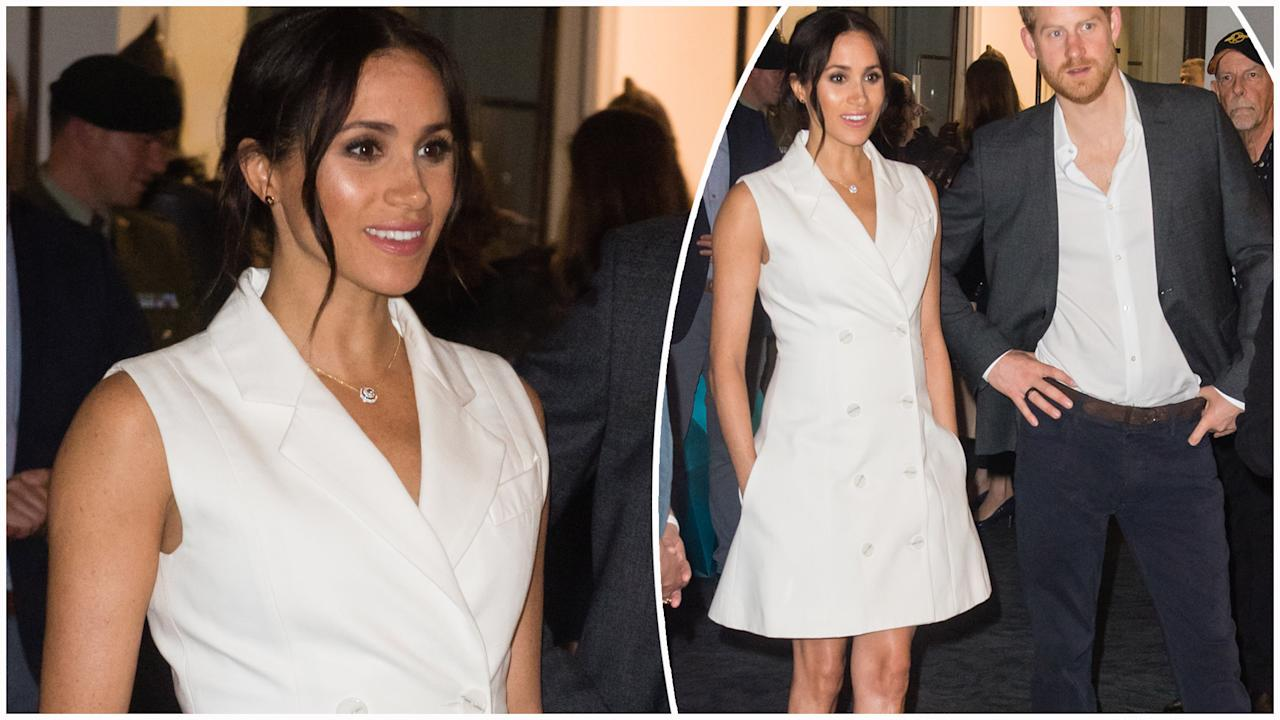 <p>The royals don't regularly get their knees out, but Meghan Markle proved she and Prince Harry are carving their own rules when she stepped out in this tuxedo mini dress. Photo: Getty </p>