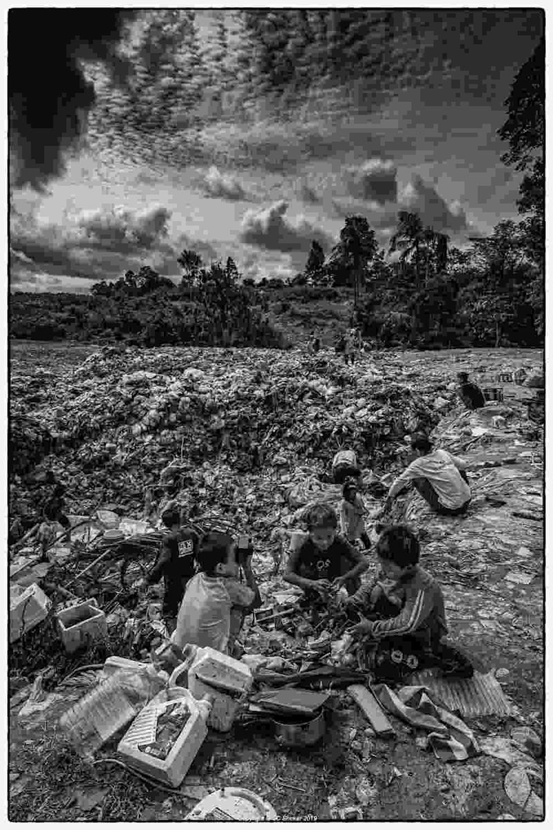 Children runing around barefoot amongst the garbage are often injured by broken glass, rusty tin cans and other sharp objects. ― Picture by SC Shekar
