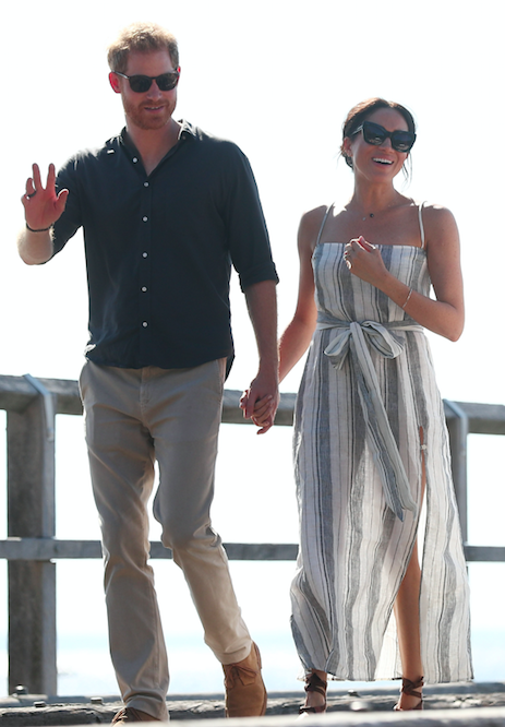 <p>The Duchess was all smiles and had her hair tied back in a messy bun. Photo: Getty </p>