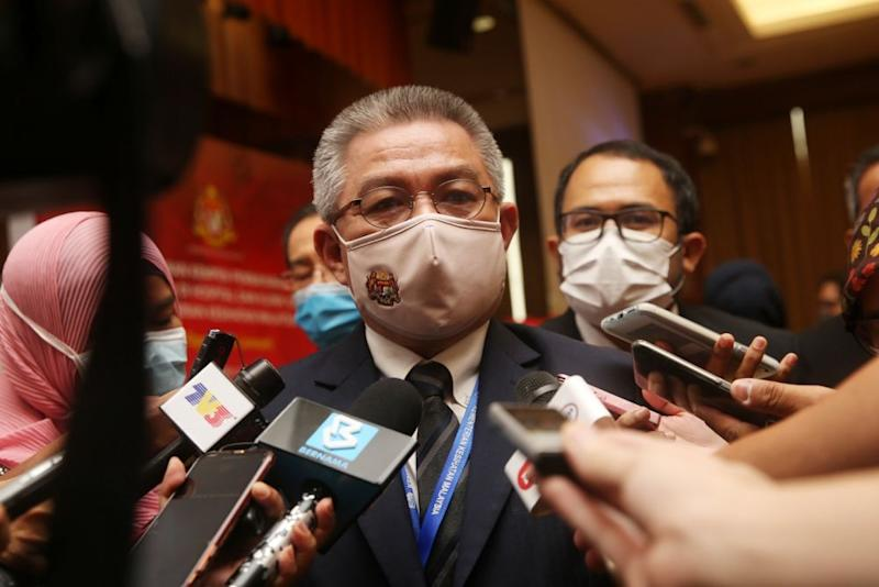 Datuk Seri Dr Adham Baba speaks to reporters after a press conference at the Health Ministry in Putrajaya August 14, 2020. — Picture by Choo Choy May