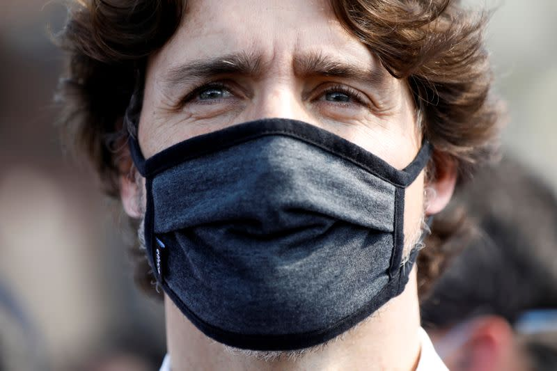 Canada's Prime Minister Justin Trudeau wears a mask as he takes part in a rally against the death in Minneapolis police custody of George Floyd, on Parliament Hill, in Ottawa