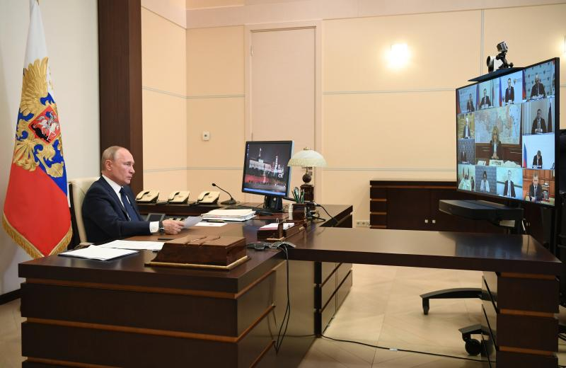 Russian President Vladimir Putin, addresses the nation via video conference at the Novo-Ogaryovo residence outside Moscow, Russia, Monday, May 11, 2020. Putin, speaking in a televised address to the nation Monday, said that it will be up to the governors of Russia's far-flung to determine what industrial plants could reopen starting Tuesday. He emphasized that it's essential to preserve jobs and keep the economy running provided that workers strictly observe sanitary norms.(Alexei Nikolsky, Sputnik, Kremlin Pool Photo via AP)