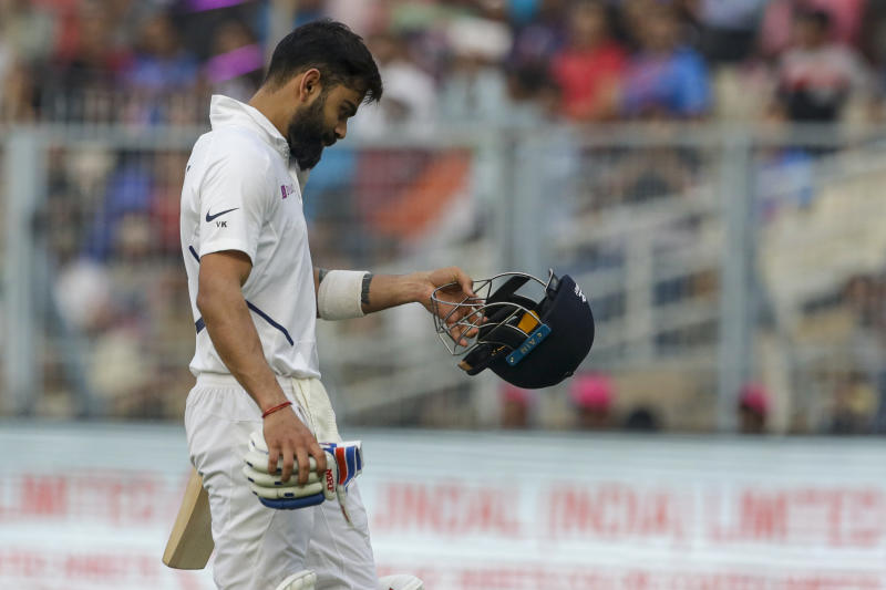 India's captain Virat Kohli gestures as he returns to the pavilion after being dismissed during the second day of the second test cricket match between India and Bangladesh, in Kolkata, India, Saturday, Nov. 23, 2019. (AP Photo/Bikas Das)