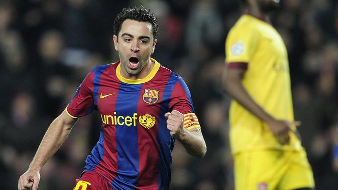 Xavi Hernandez saat membela Barcelona. (AFP/Josep Lago)