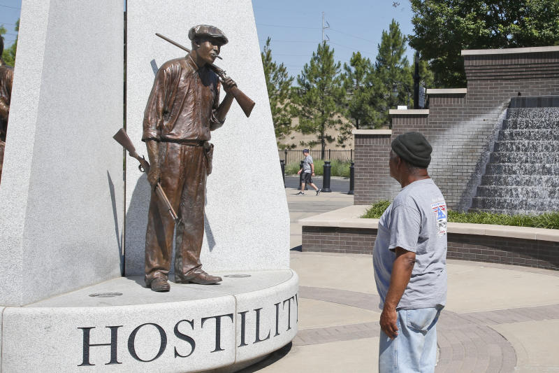 Donald Shaw looks at a sculpture in the John Hope Franklin reconciliation park in Tulsa, Okla., Monday, June 15, 2020, a few hundred yards and on the other side of what's historically the city's white-black dividing line, where President Donald Trump will rally Saturday, June 20. (AP Photo/Sue Ogrocki)