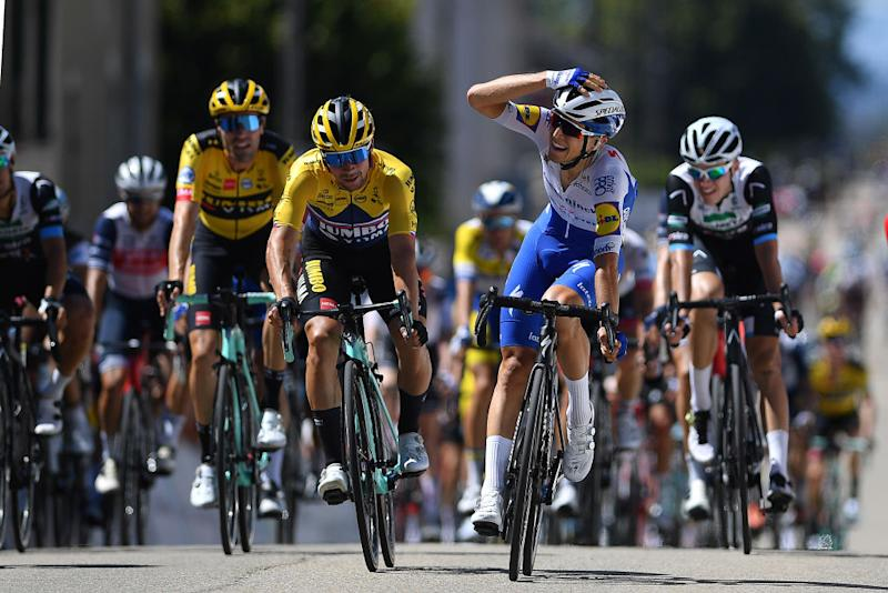 Andrea Bagioli of Deceuninck-Quick-Step crosses line for win in Ceyzeriat, France