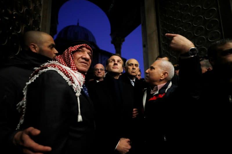 Macron berates Israeli security men in tussle at Jerusalem church
