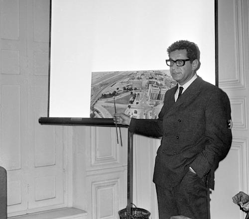 "FILE - In this Oct. 4, 1966 file photo, American lawyer Mark Lane points to a photo showing the route followed by the late President John F. Kennedy on Nov. 22, 1963 in Dallas, during a news conference in Paris criticizing the report of the Warren Commission. On the chart is a bush from which he claims that shots were fired toward the motorcade. In his book ""Rush to Judgment"" the commission, he argued, ""frequently chose to rely on evidence that was no stronger and sometimes demonstrably weaker than contrary evidence which it rejected."" (AP Photo/Card)"