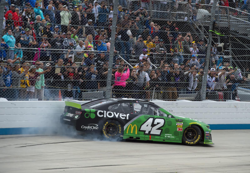 Kyle Larson does a burnout after winning the NASCAR Cup Series playoff auto race Sunday, Oct. 6, 2019, at Dover International Speedway in Dover, Del. (AP Photo/Jason Minto)