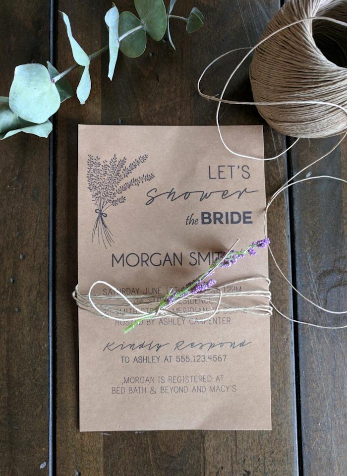 """<p>In honor of the soon-to-be beautiful bride, welcome guests with a homemade card that's wrapped with an ethereal sprig of dried flowers. </p><p><strong>Get the tutorial at <a href=""""https://joyfullygrowingblog.com/how-to-create-diy-invitations-using-microsoft-publisher-free-font-downloads/"""" target=""""_blank"""">Joyfully Growing</a>.</strong></p>"""
