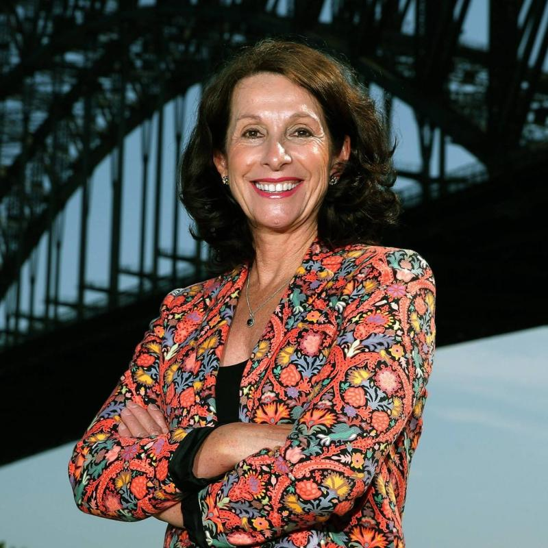 North Sydney mayor Jilly Gibson smiles to the camera under the Sydney harbour bridge.