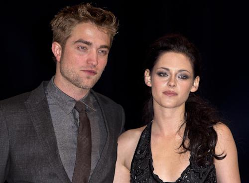 "FILE - In this Nov. 16, 2011 file photo, British actor Robert Pattinson, left, and US actress Kristen Stewart arrive at the UK film premiere of ""Twilight Breaking Dawn Part 1"" at Westfield Stratford in east London. On Wednesday, July 25, 2012, Kristen Stewart and director Rupert Sanders are apologizing publicly to their loved ones following reports of infidelity. (AP Photo/Joel Ryan, File)"