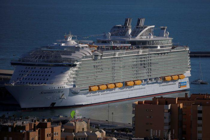 A very, very big cruise ship docked in Spain