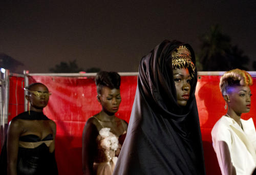 Models wear designs by Elie Kuame of Lebanon and Ivory Coast as they wait to walk the runway at Hotel des Almadies, in Dakar, Senegal, Saturday, June 22, 2013. After a Friday show held in a dusty marketplace in the working class suburb of Guediawaye, the runway finale of Dakar Fashion Week was held at a luxury hotel and showcased the work of 14 designers from West Africa, Europe, South America, and the Caribbean. (AP Photo/Rebecca Blackwell)