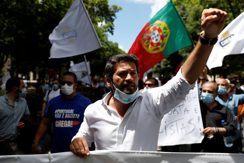 Portugal's far-right party Chega leader Andre Ventura shouts slogans during a protest against those who say racism exists in the country, in downtown Lisbon