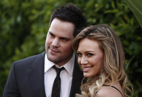 "FILE - In this May 11, 2011 file photo, Hilary Duff, right, and Mike Comrie arrive at an Evening of ""Southern Style"" presented by The St. Bernard Project and the Spears Family in Beverly Hills, Calif.  Duff and her husband Comrie are calling it quits after three years or marriage according to Duff's reps. on Friday, Jan. 10, 2014. (AP Photo/Matt Sayles, File)"