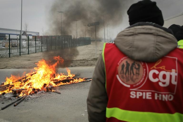 French strikers set fires and barricades to block access to the port at Le Havre on Wednesday to protest the pension overhaul