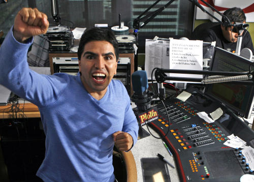 "FILE - In this Oct. 17, 2008 file photo, Mexican-American radio personality Eddie ""Piolin"" Sotelo records his show ""Piolin por la Manana"" at a radio studio in Glendale, Calif. Univision Radio Network's nationally syndicated Spanish-language program has been canceled. Univision did not release the reason for dropping the morning talk show hosted by Sotelo. (AP Photo/Damian Dovarganes, File)"