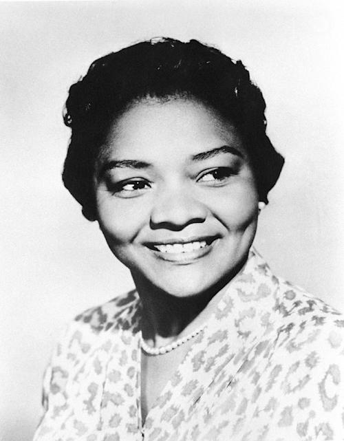"FILE - This March 31, 1960 file photo shows Juanita Moore, a groundbreaking actress and an Academy Award nominee for her role as Lana Turner's black friend in the classic weeper ""Imitation of Life."" Actor Kirk Kelleykahn, her grandson, said that Moore collapsed and died Wednesday, Jan. 1, 2014, at her home in Los Angeles. She was 99, according to Kelleykahn. Accounts of her age have differed over the years. (AP Photo, file)"