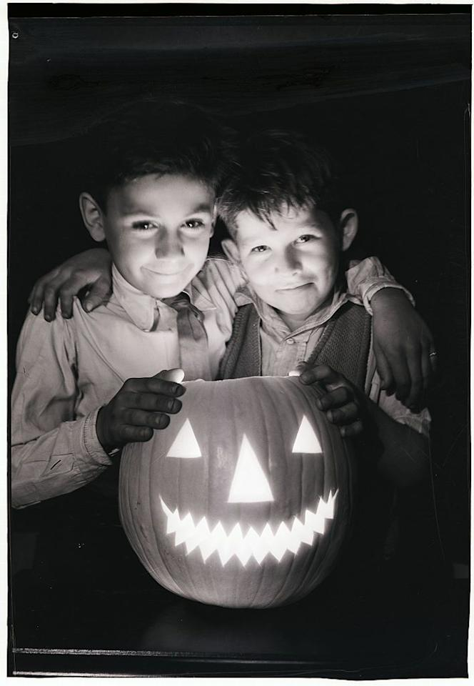 """<p>The holiday we know and love as Halloween got its roots from the <a href=""""http://www.history.com/topics/halloween/history-of-halloween"""" target=""""_blank"""">Celtic festival of Samhain</a>, during which folks would light bonfires as a way to ward off spirits before All Saint's Day on November 1. Both Samhain and All Saint's Day eventually began merging with All Souls' Day, a day designed by the Catholic church in 1000 AD to honor the dead each November 2, when people dressed up as devils, angels, and saints. However, these Halloween traditions didn't make their way to America until the second half of the 19th century, and the spooky affair went on to become synonymous with parties, parade, treats, and costumes. </p>"""