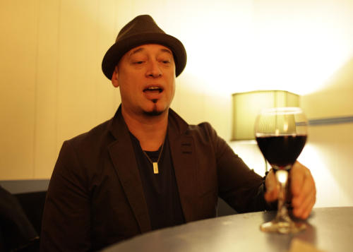 In this photo taken Wednesday April 11, 2012, Jimm Stafford of the band Train samples some of their wine before their concert at the Great American Music Hall in San Francisco. (AP Photo/Eric Risberg)