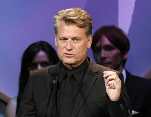 """FILE - This Oct. 2, 2009 file photo shows Joe Simpson speaking at the Operation Smile """"Smile Gala"""" in Beverly Hills, Calif. Los Angeles prosecutors are charging Simpson with two counts of drunken driving after his arrest earlier this month. City attorney's spokesman Frank Mateljan said Wednesday that 54-year-old Joe Simpson faces a maximum sentence of 6 months in jail, 36 months of probation and a $1,000 fine. He was arrested Aug. 4 after authorities say he registered a blood-alcohol level of 0.08 percent or above at a DUI checkpoint in the Sherman Oaks area. (AP Photo/Dan Steinberg, file)"""