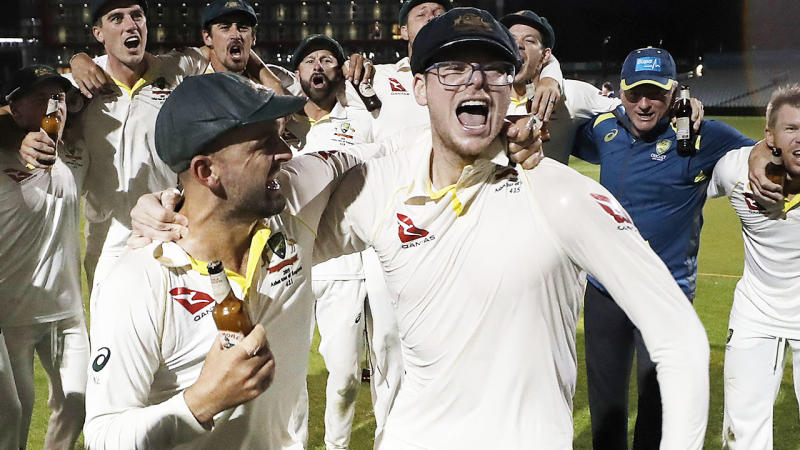 Steve Smith, pictured here wearing glasses during celebrations after the fourth Ashes Test.