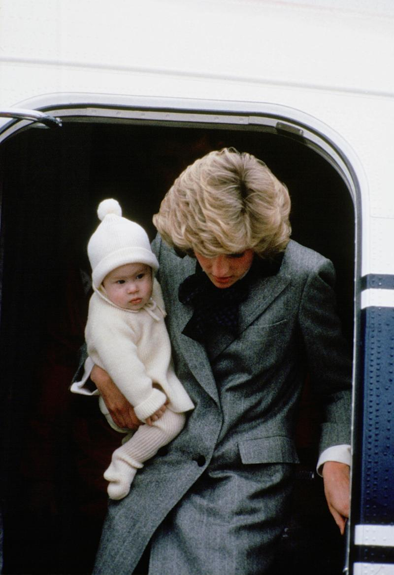 Diana, Princess of Wales carries her son, Prince Harry, off a flight at Aberdeen Airport (Photo by Tim Graham/Getty Images)