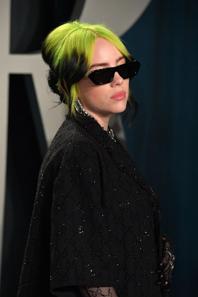 """<p>Most people would totally be afraid to dye their roots neon green, but Billie went for it and the look didn't disappoint. Though the <a href=""""https://www.seventeen.com/beauty/celeb-beauty/a29713092/billie-eilish-mullet/"""" target=""""_blank"""">haircut was an accident</a>, she's been rocking the style ever since. </p>"""
