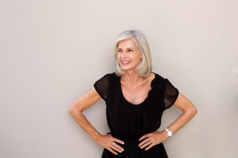 older woman wearing black dress, look better after 40