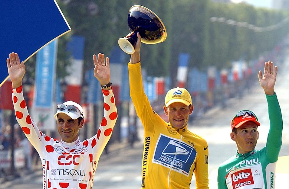 FILE - This July 28, 2002 file photo shows Tour de France winner Lance Armstrong, center, flanked by best sprinter Robbie McEwen, of Australia, right, and best climber Laurent Jalabert, of France, after the 20th and final stage of the Tour de France cycling in Paris. The superstar cyclist, whose stirring victories after his comeback from cancer helped him transcend sports, chose not to pursue arbitration in the drug case brought against him by the U.S. Anti-Doping Agency. That was his last option in his bitter fight with USADA and his decision set the stage for the titles to be stripped and his name to be all but wiped from the record books of the sport he once ruled.  (AP Photo/Peter Dejong, File)