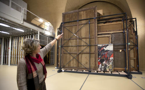 "Press and communications officer Veronique Van Passel points to a curved slot in which larger paintings were passed from the top floor to the bottom floor inside the interior warehouse of the Antwerp Royal Museum of Fine Arts in Antwerp, Belgium on Thursday, April 4, 2013. Just as the famous Amsterdam Rijksmuseum in neighbouring Netherlands has returned ""The Night Watch"" of its most famous painter, Rembrandt van Rijn, back in the main building after a ten-year renovation, Antwerp is hiding five oversized Rubens paintings in a special depot to protect them against the rough and tumble of four more years of works. (AP Photo/Virginia Mayo)"