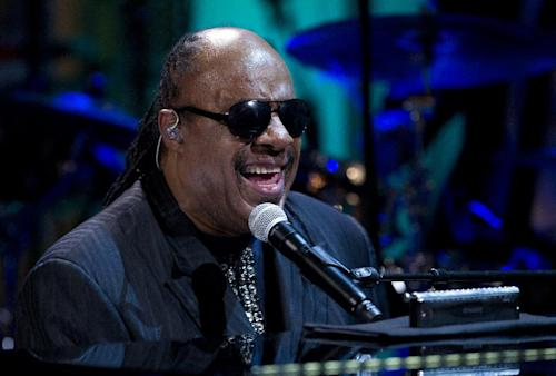 "FILE - In this May 9, 2012 file photo, Stevie Wonder performs during the ""In Performance at the White House"" in the East Room of the White House in Washington, honoring songwriters Burt Bacharach and Hal David. A judge ruled on Thursday July 12, 2012 that two people, including his cousin, who tried to extort the musician should stand trial. (AP Photo/Carolyn Kaster, File)"
