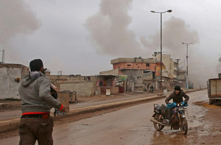 Some of the last remaining residents of the rebel-held town of Atareb flee as Syrian government forces draw ever closer in their offensive against the last major rebel pocket of Idlib