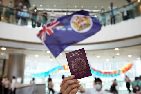 A protester holds a BN(O) passport during a lunch hour anti-government demonstration at IFC Mall in Central on May 29. Photo: Winson Wong
