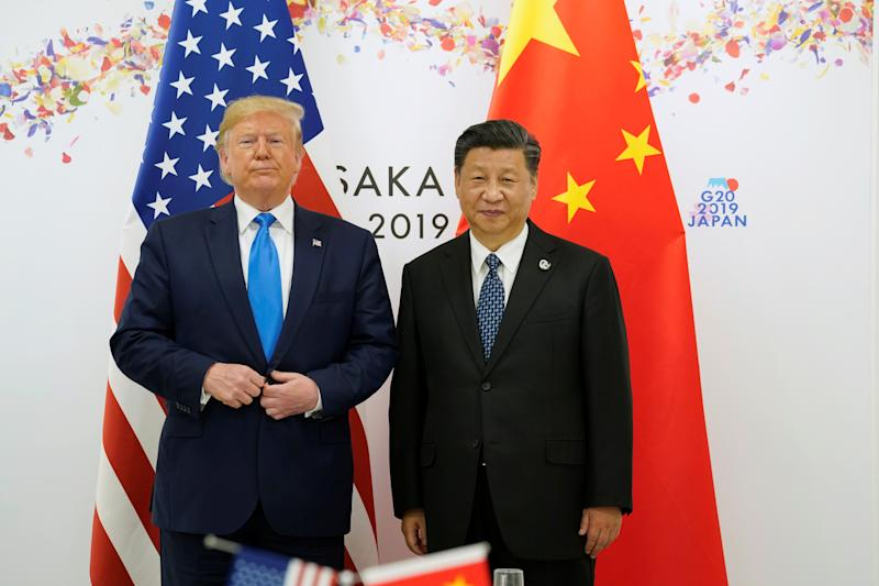 U.S. President Donald Trump poses for a photo with China's President Xi Jinping before their bilateral meeting during the G20 leaders summit in Osaka, Japan, June 29, 2019. REUTERS/Kevin Lamarque