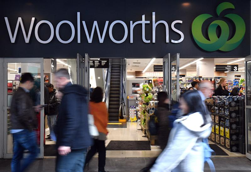 Pedestrians walk pass a Woolworths store in Sydney. Source: AAP