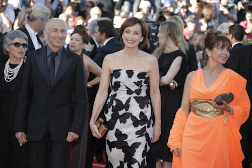 From 2nd left, director of photography Philippe Rousselot, actors Kristin Scott Thomas and Victoria Abril arrive for the screening of the film The Immigrant at the 66th international film festival, in Cannes, southern France, Friday, May 24, 2013. (AP Photo/Lionel Cironneau)