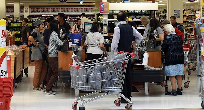At selected Coles supermarkets shoppers will be unable to use trolleys and it will be baskets only at self-service checkouts as part of a new trial. Image: AAP