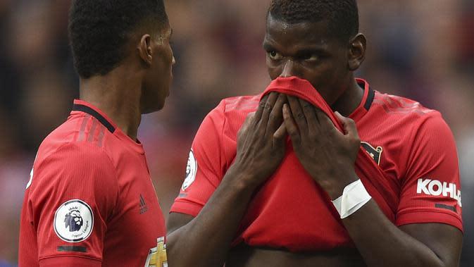 Pemain Manchester United, Marcus Rashford dan Paul Pogba. (AFP/Oli Scarff)