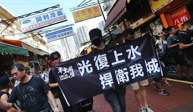 Localists protest against mainlanders crossing into Sheung Shui for trade. Photo: David Wong