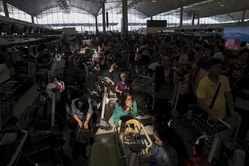 protesters stage a sit-in rally at he Hong Kong International Airport in Hong Kong, Tuesday, Aug. 13, 2019.