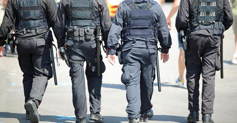 four cops patroling the city