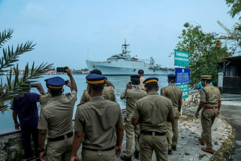 The warship INS Jalashwa carrying 698 Indians from the Maldives capital of Male arrived at Cochin port on the southwestern coast of India