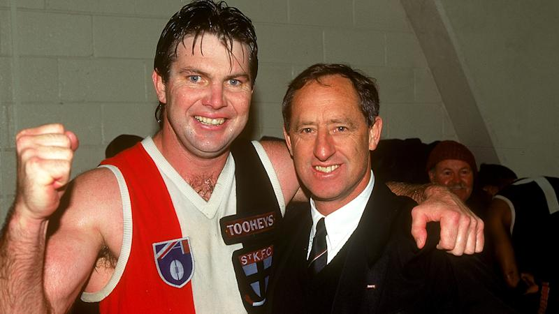 Danny Frawley of the Saints celebrates with coach Stan Alves after a AFL match between the St Kilda Saints and the Carlton Blues held at the Melbourne Cricket Ground, 1995 in Melbourne, Australia. (Photo by Getty Images)