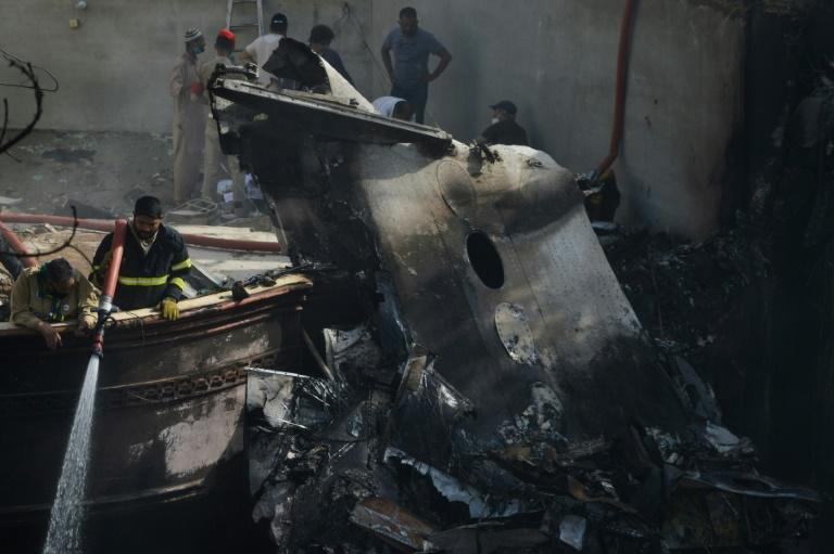Flames and plumes of smoke were sent into the air as the plane crashed onto a street, its wings slicing through rooftops