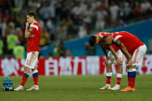 Russia's players react to their defeat on penalties by Croatia in the World Cup quarter-finals