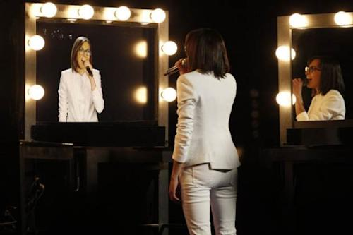Michelle Chamuel performs into a video mirror on 'The Voice,' June 17, 2013 -- NBC